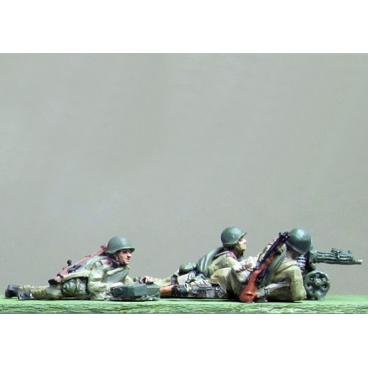 Maxim gun team, helmet, firing